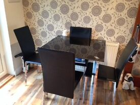 Black glass dinning table