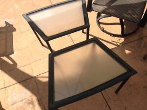 Four Black rocker/swivel patio chairs. SOLD PPU