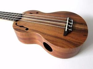 Ukulele Soprano Top solide Acacia f-hole Stagg