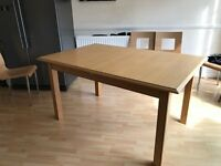 M & S Oak Kitchen table seats 6 - extends out to seat 8