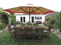 Garden table and chairs ,cushions parasol. EXCELLENT CONDITION