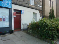 HENDERSON ROW - Bright lower ground flat with direct access to shared garden