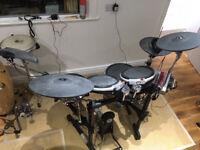Yamaha DTXtreme electronic drum kit on Roland stand.