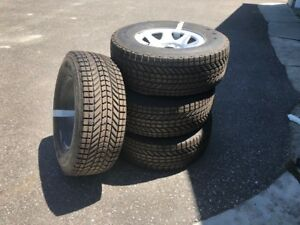 Winter Tires 17 inch on steel rims $850.00 firm, Like New.