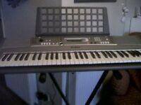 Yamaha Keyboard with adjustable stand.