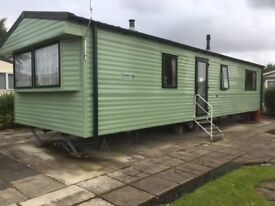 Fantastic starter two bedroom caravan on great pitch