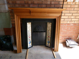 Cast iron fire surround, wooden surround and black tiled base