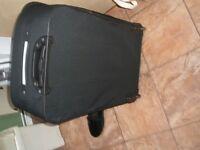 large black extending suitcase