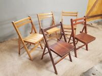 Five wooden vintage folding chairs