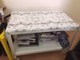 White IKEA side-table with marble pattern and wheels (Tingby)