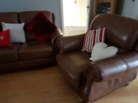 italian leather three seater two chairs (1 recliner) & poufee. Less than two years old