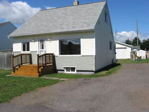 Updated 4 Bedroom Westfort Home with HUGE Mechanics Dream Garage