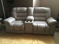 Ivory Leather Reclining Sofa with Center Console and Cup Holders