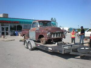 Custom car hauling empty trailer from Winnipeg to LLoydminister
