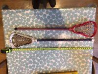 Two girls' lacrosse sticks
