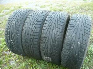 Four 255-60-18 snow tires  $300.00