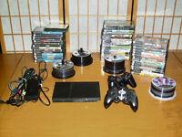 ★ PS2 Slim hacké + Beaucoup de jeux!!