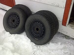Set of 4 winter tires with rims.  P195-70R14