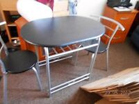 black and silver table and 2 chairs