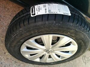 New 4 x 195/65R15 Volkswagen winter tires on OEM rims