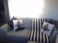 Lovely mint-colour, fabric, three-seater sofa for sale