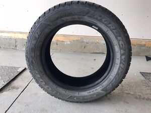 One month old  set of 4 Winter studded tires P235 60R18 for sale