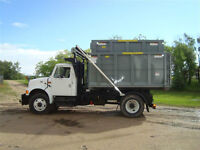 Hooklift dumpster truck and dumpsters