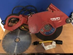 "Hilti 12"" Electic concrete saw w/ additional steel cutting disc"