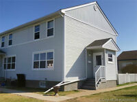 AFFORDABLE LIVING - END UNIT CONDO IN SPRINGBROOK