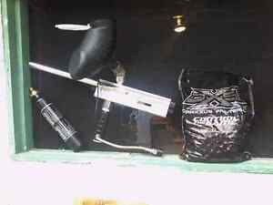 DXS Paintball 2000l Rounds with paintball gun.