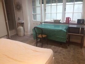 Studio room in family home, available now