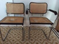 2 beautiful retro cantilever chairs with cane wicker seat and back (inc one carver with arms)