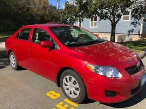 2009  Red Toyota Corolla CE 4 door Automatic