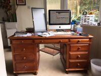Desk - Large hardwood desk with 9 drawers