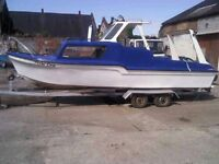 20ft Fibreglass boat with 30HP Tohatsu outboard and trailer