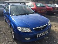 2003 Mazda 323, starts and drives well, very low mileage of 65,000 miles, car located in Gravesend K