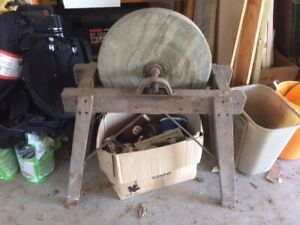 antique stone grinder and stand