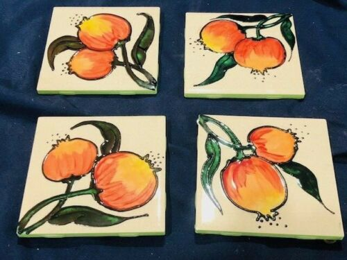 set of 4 Mexican glazed pottery tiles with golden pomegranates 4 1/4 x 4 1/2 in