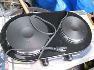 portable cooking range black it is NEW