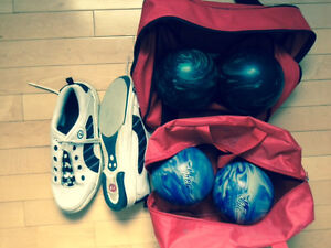 4 Bowling Balls in bags with shoes.