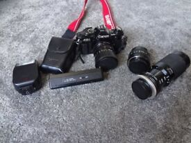 Canon AE-1 35mm film Camera in shiny black with Accessories