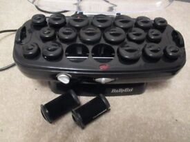 Babyliss heated rollers - comes with the clips to hold the rollers in. Excellent condition