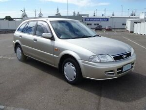 2002 Ford Laser KQ KQ LXI HATCHBACK 5DR MAN 5SP 1.6I Champagne 5 Speed Manual Hatchback South Burnie Burnie Area Preview