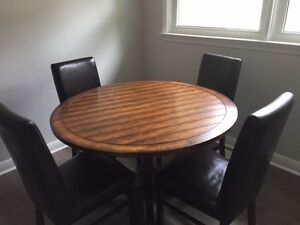 4 ft round wooden table with 6 leather chairs