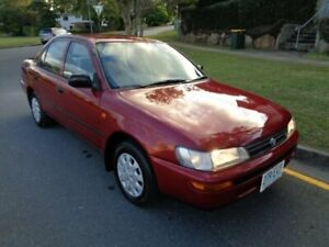 1995 Toyota Corolla AE101R CSi Red Metallic 4 Speed Automatic Sedan Chermside Brisbane North East Preview