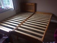 Solid pine single bed with a bed that rolls out and pops up. Great for sleepovers. Good condition.