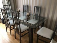 GLASS DINING TABLE WITH CHAIRS, IMMACULATE CONDITION. CHAIRS STILL IN WRAPPER