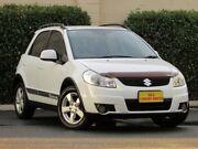 2011 Suzuki SX4 GYB MY10 White 6 Speed Manual Hatchback Blair Athol Port Adelaide Area Preview