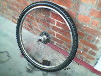 26 inch rear mountain bike wheel, 7 speed casette flywheel, quick release.