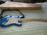 Electric Guitar with Amplifier and Tuner